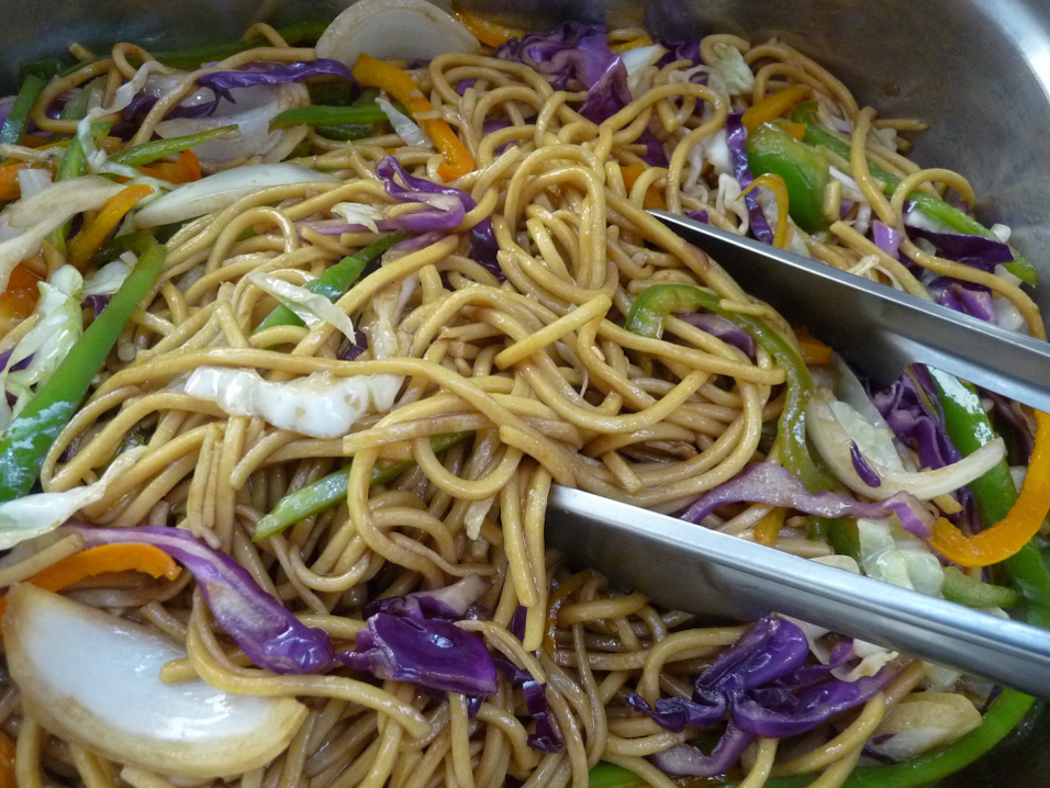 chicken chow mein with red cabbage, onions, and egg noodles
